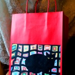 Mewsette on the Afghan gift bag, red.