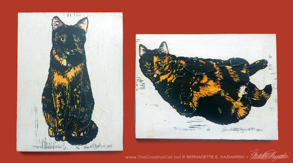 Wood-mounted Tortie Girls prints on a color-coordinating wall.