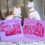Violet cards with red ink, two designs.