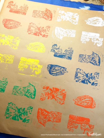 "Wrapping paper, ""Tabbies"", in primary colors."