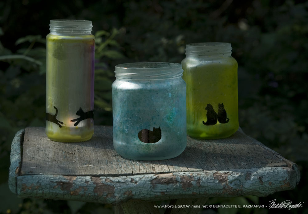Feline Votives made from repurposed condiment jars.