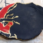 "Black and red with gold, ""The Big Nap"" decorative dish."