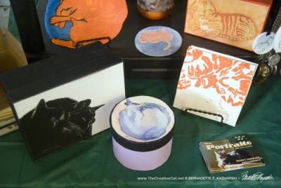 More orange and violet cat gift items.
